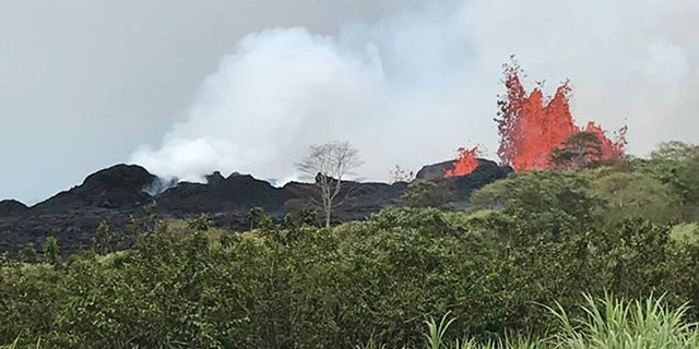 Lava erupts from Fissure 22 on Hawaii's Kilauea volcano on Monday, shooting up to 150 feet in the air.
