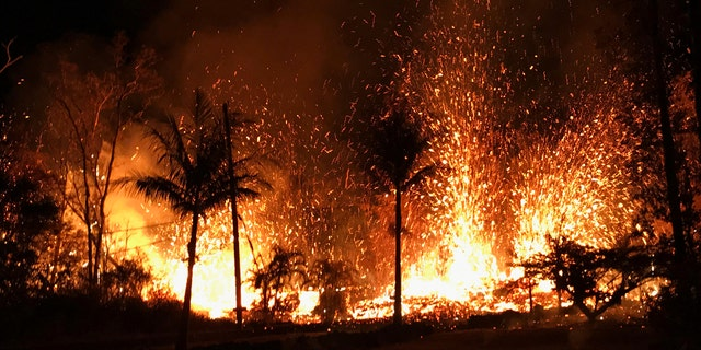 In this Saturday, May 5, 2018 photo, a new fissure erupts in Leilani Estates in Pahoa, Hawaii.