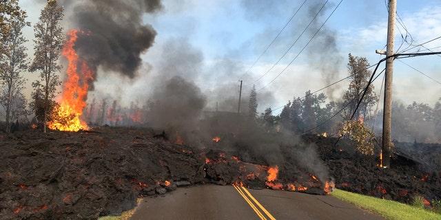 Lava advances along a street near a fissure in Leilani Estates, on Kilauea Volcano's lower East Rift Zone, Hawaii, the U.S., May 5, 2018.
