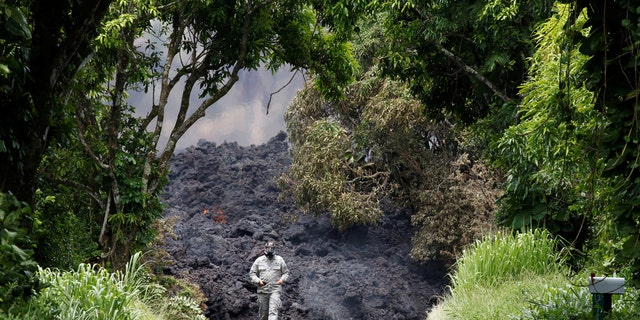 A lava flow on Highway 137 southeast of Pahoa during ongoing eruptions of the Kilauea Volcano.