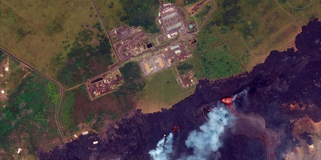 This May 23, 2018, Satellite photo provided by DigitalGlobe shows lava coming out of fissures caused by Kilauea volcano, near Puna Geothermal Venture, a geothermal energy plant, in Pahoa, Hawaii.