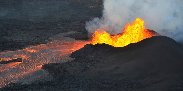 This photo provided by the U.S. Geological Survey shows lava fountaining at a fissure near Pahoa on the island of Hawaii Tuesday.