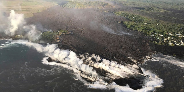 This photo provided by U.S. Geological Survey shows an aerial view of ocean entry at Kapoho Bay, Hawaii on Tuesday, June 5, 2018.