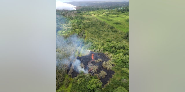 This Saturday, May 12, 2018, image released by the Hawi'i County Fire Department, shows an aerial view of fissure 16, located about 1.3 km (0.8 miles) northeast of fissure 15, top left, i9n the Big Island of Hawaii.