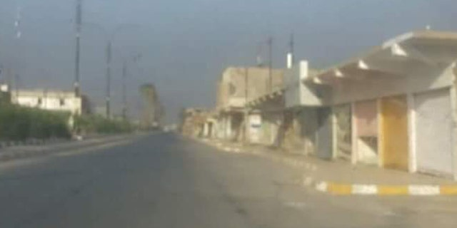 The city of Hawija is a bleak landscape of garbage and deserted buildings.