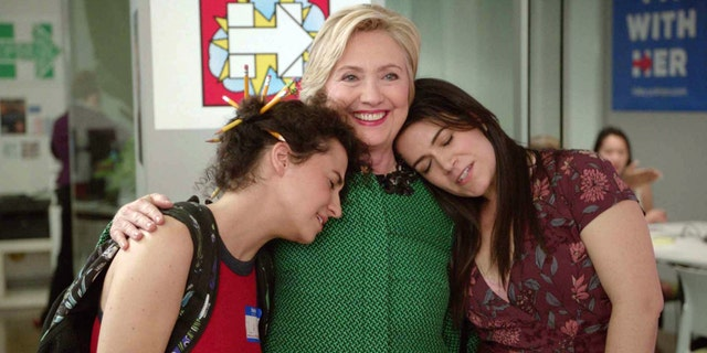 "Ilana Glazer (left) with Hillary Clinton (center) and Abbi Jacobson in a scene from season three of ""Broad City."""