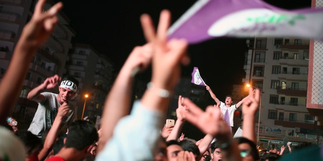 HDP supporters celebrate the party's election results in Diyarbakir, Turkey