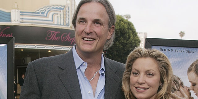 """Nick Cassavetes (L), director of the new drama film """"The Notebook"""" poses with actress Heather Wahlquist from the film, as they arrive for the film's premiere in Los Angeles, June 21, 2004."""