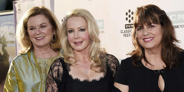 """Cast members actresses Heather Menzies-Urich (L), Kym Karath (C) and Debbie Turner pose during 50th anniversary screening of musical drama film """"The Sound of Music"""" at the opening night gala of the 2015 TCM Classic Film Festival in Los Angeles, California March 26, 2015. Menzies-Urich is dead at 68."""