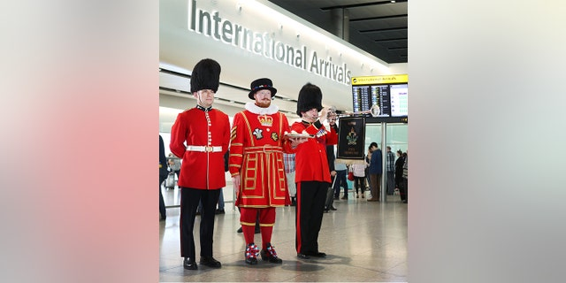 People passing through arrivals will be greeted by the sight of a Queen's Guard, a Beefeater and the sounds of a royal trumpeter.