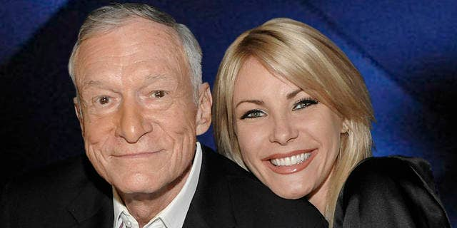 """Hugh Hefner, left, and model Crystal Harris at a party celebrating the release of the book """"Hugh Hefner's Playboy"""" a limited edition anthology by Taschen in Beverly Hills, Calif. on Thursday, Dec. 10, 2009.  (AP Photo/Dan Steinberg)"""