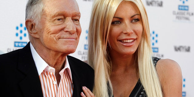 Hugh Hefner and Playboy Playmate Crystal Harris, arrive at the opening night gala of the 2011 TCM Classic Film Festival featuring a screening of a restoration of 'An American In Paris' in Hollywood, California April 28, 2011.