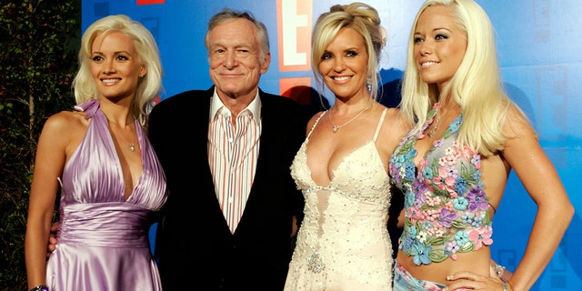 Playboy founder Hugh Hefner and his three girlfriends Holly Madison, Bridget Marquardt and Kendra Wilkinson (R) at the E! Entertainment television summer splash party at the Tropicana Bar at the Roosevelt Hotel in Hollywood.