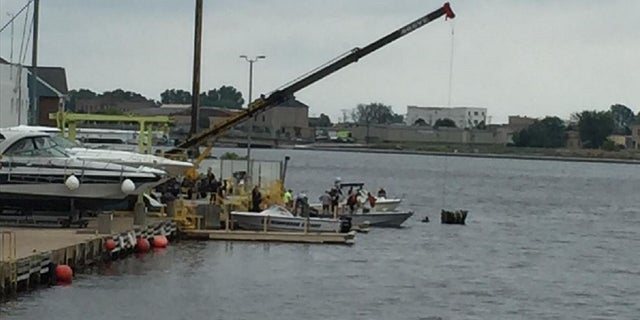 A man is confirmed dead after a helicopter crashed into the Fox River in Wisconsin on Saturday, officials said.