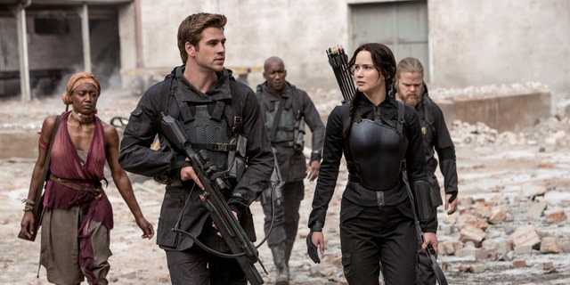 """Jennifer Lawrence portrays Katniss Everdeen, right, and Liam Hemsworth portrays Gale Hawthorne in a scene from """"The Hunger Games: Mockingjay Part 1."""""""