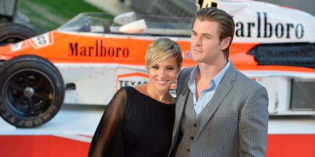 """Hemsworth, seen here in 2013 with his wife Elsa, played Formula One driver James Hunt in the film """"Rush."""""""