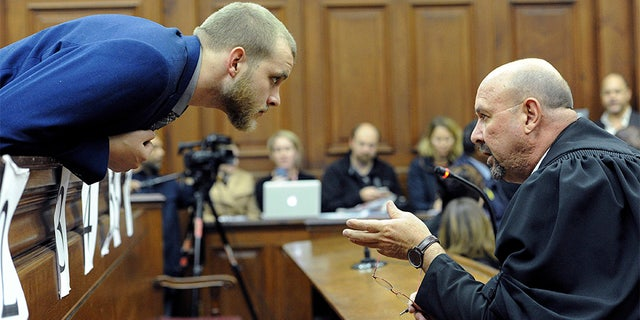 May 21, 2018: Henri van Breda, left, talks to one of his legal adviser, Piet Botha, right, in the High Court.