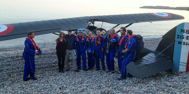 Coast Guardsmen helped Rockey and Spiller tow the aircraft to a safer location down the beach.