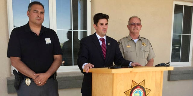 New Mexico First Judicial District Attorney Marco Serna, center, describes on Friday a shooting rampage spanning nearly 200 miles across New Mexico that left four people dead.