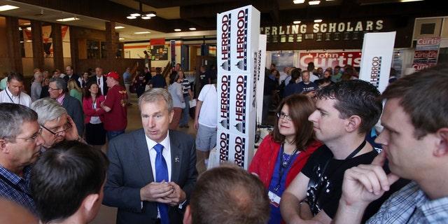 Former Utah lawmaker Chris Herrod, speaks with delegates before start of a 2017 special convention Saturday, June 17, 2017 in Provo, Utah