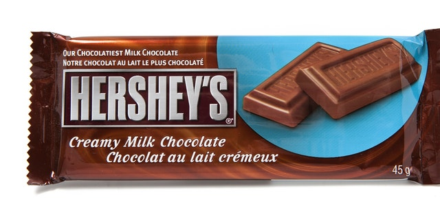 Toronto, Canada - May 8, 2012: This is a studio shot of Hershey's Creamy Milk Chocolate made by Hershey's isolated on a white background.