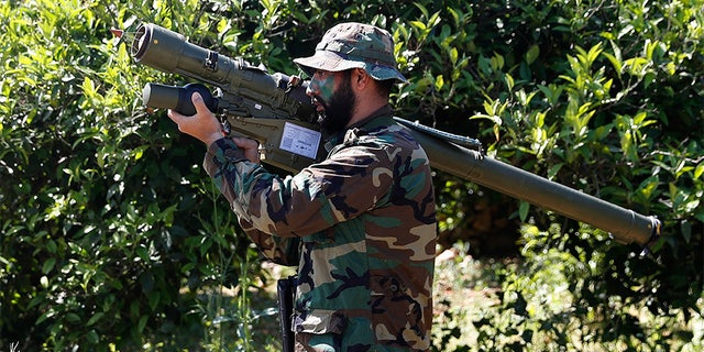 April 20, 2017: A Hezbollah fighter holding an Iranian-made anti-aircraft missile on the border with Israel, in Naqoura, south Lebanon.