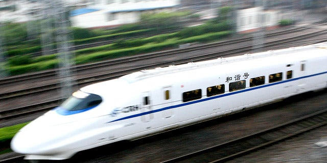 In this photo released by China's Xinhua News Agency, a train with a speed of 200 kph (124 mph) leaves Shanghai bound for Suzhou, in China, Wednesday,  April 18, 2007. Chinese trains running at up to 200 kph (124 mph) began service on Wednesday as part of a new bid to keep up with ballooning transport demand, state media reported. The first of scores of high-speed trains left Shanghai at 5:38 a.m. (2138 GMT) Wednesday morning for the nearby city of Suzhou, covering the approximately 85 kilometers (53 miles) in about 39 minutes, the Xinhua News Agency reported.  (AP Photo/Xinhua, Chen Fei)