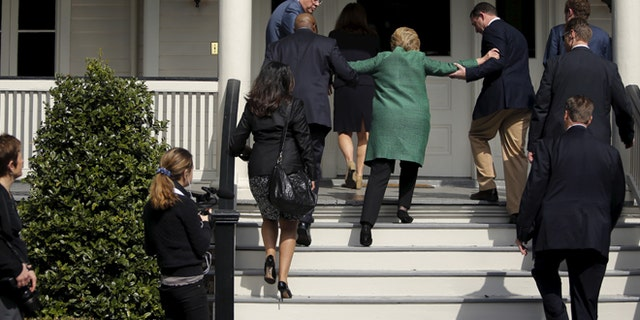 Hillary Clinton lost her balance briefly as she arrived for a tour of a home for ex-offenders and substance abusers in North Charleston, S.C., on Feb. 24, 2016.