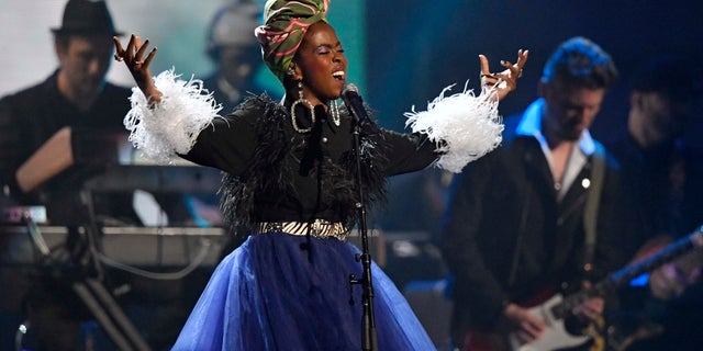 Recording artist Lauryn Hill pays tribute to Nina Simone during the Rock and Roll Hall of Fame induction ceremony, Saturday, April 14, 2018, in Cleveland.