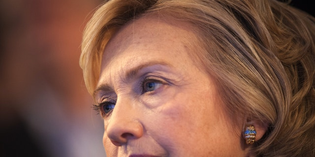 Former U.S. Secretary of State and former U.S. first lady Hillary Clinton sits and watches during the Clinton Global Initiative 2013 (CGI) in New York September 24, 2013.