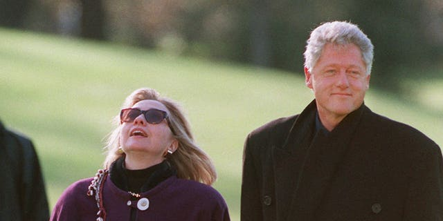 President and Mrs. Clinton walk to the White House after arriving by Marine One on the South Lawn Wednesday, Nov. 27, 1996