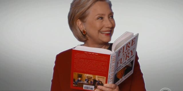 """Hillary Clinton reads from """"Fire and Fury"""" during the Grammy Awards on Jan. 28, 2018."""