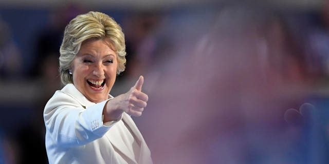 Democratic presidential nominee Hillary Clinton give a thumbs up after taking the stage to make her acceptance speech during the final day of the Democratic National Convention in Philadelphia , Thursday, July 28, 2016.