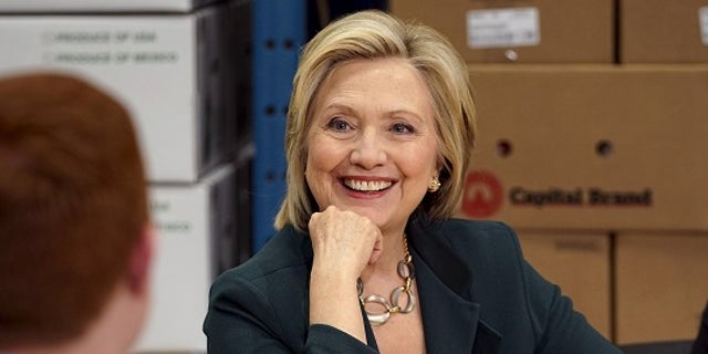 April 15, 2015: Presidential candidate and former Secretary of State Hillary Clinton listens to small business owners as she campaigns for the 2016 Democratic presidential nomination at Capital City Fruit in Norfolk, Iowa.