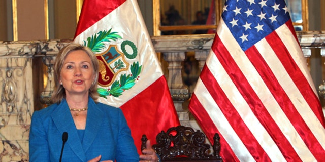 Secretary of State Hillary Rodham Clinton talks to reporters after a meeting with Peru's President Alan Garcia at the presidential palace in Lima, Monday, June 7, 2010. (AP)