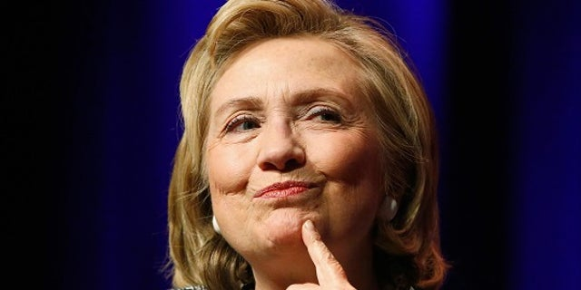 """FILE -- June 13, 2014: Former Secretary of State Hillary Clinton reacts to a question as she discusses her book """"Hard Choices: A Memoir"""" at George Washington University in Washington."""