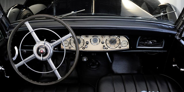 The Mercedes has been cosmetically restored inside and out.