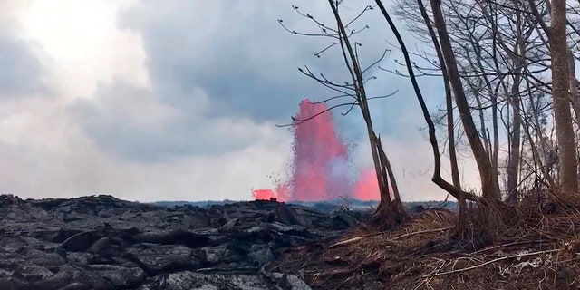 This May 29, 2018 photo from video provided by the U.S. Geological Survey shows lava from a fissure created fountains to heights of 200 feet at times, near Pahoa, Hawaii.