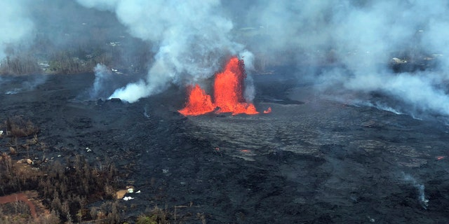 In this Saturday, May 26, 2018, image released by the U.S. Geological Survey HVO shows an aerial view of fissure 22 looking toward the south, as Kilauea Volcano continues its eruption cycle near Pahoa on the island of Kilauea, Hawaii.