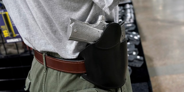 FILE: A concealed carry holster is displayed for sale at a gun show in Pennsylvania.