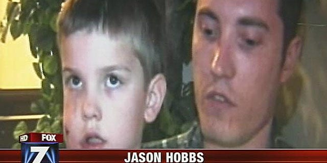 Rivers Hobbs with his father, Jason Hobbs, who stabbed the mountain lion with a pocketknife, causing it to flee.