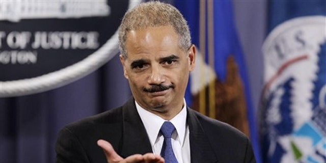 Attorney General Eric Holder speaks at a news conference at the Justice Department in Washington Nov. 29. (AP Photo)