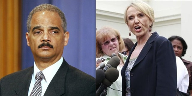 Shown here are Attorney General Eric Holder and Arizona Gov. Jan Brewer. (AP Photos)