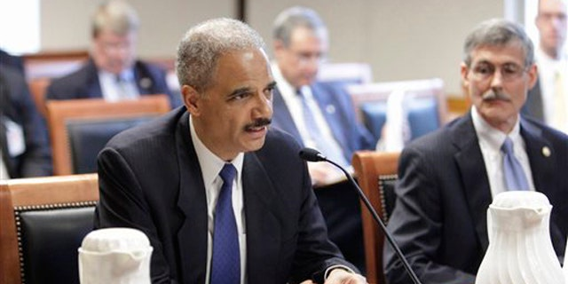 Attorney General Eric Holder testifies before the U.S. Sentencing Commission June 1 at the Thurgood Marshall Federal Judiciary Building in Washington.
