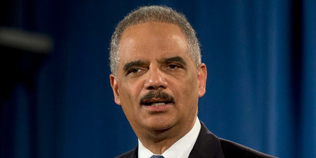 In this March 4, 2015, file photo, then-Attorney General Eric Holder speaks at the Justice Department in Washington.
