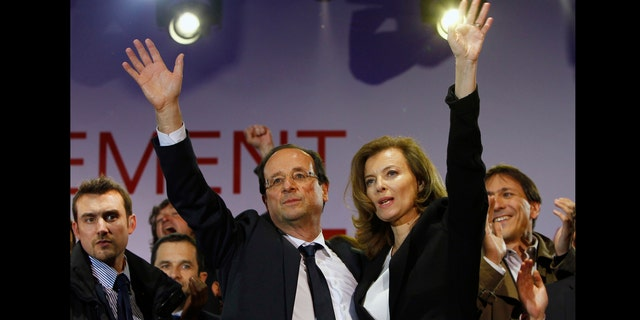 French president-elect Francois Hollande, center left, wave to supporters with his companion Valerie Trierweiler after greeting crowds gathered to celebrate his election victory in Bastille Square in Paris.