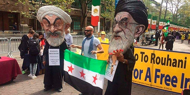 Protestors outside the UN oppose the Iranian regime's role in the bitter Syrian war and support of dictatorial President Bashar al-Assad.