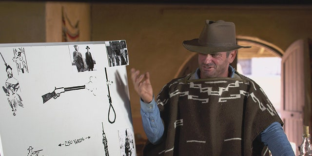 "Schappert, in Clint-appropriate garb, prepares to test a scene from ""The Good, the Bad and the Ugly."""