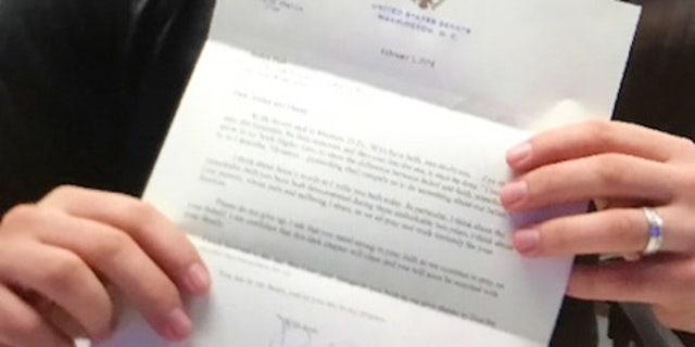 Joshua Holt in a Venezuelan jail holding a letter he received last Friday from Sen. Orrin Hatch.