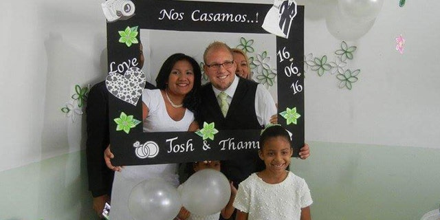 Joshua Holt and Thamara Candelo on their wedding day. Thamara's daughter, Nathalia, 7, is in the foreground.